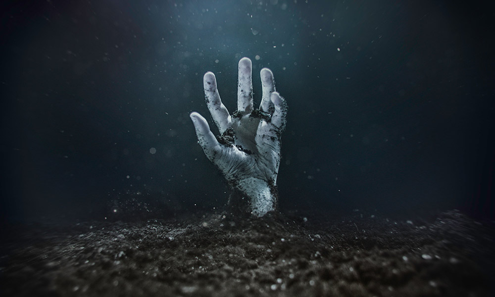 hand rising out of the grave - a trope in horror films