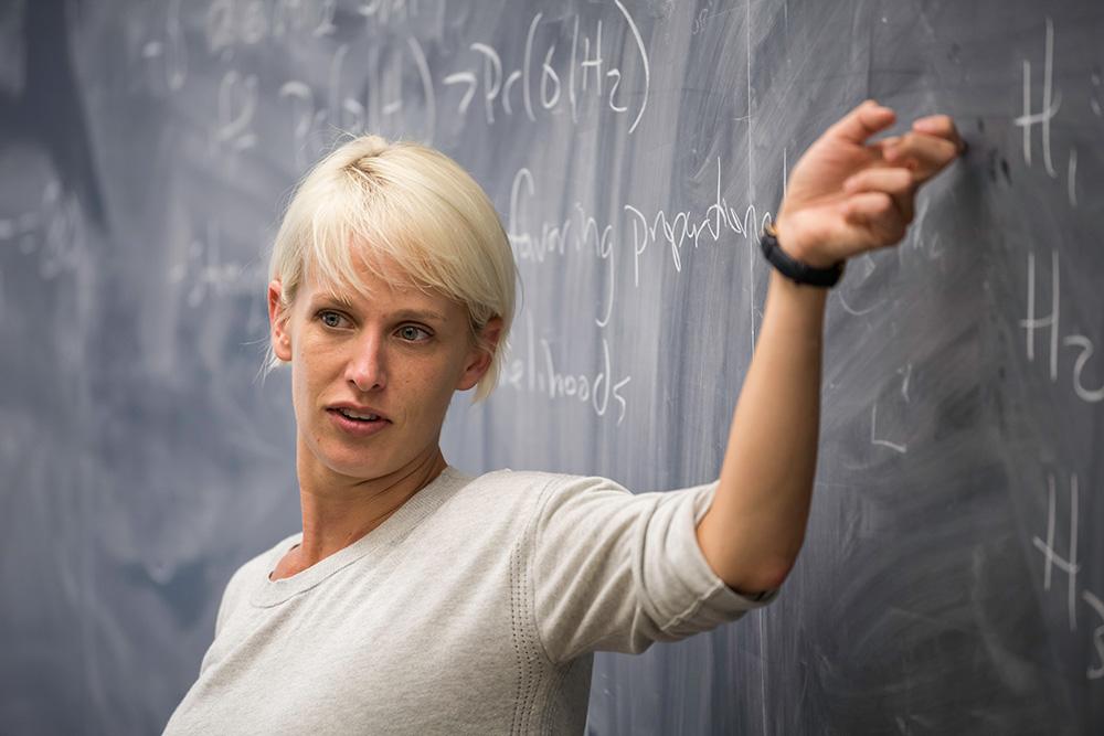 Hayley Clatterbuck at a blackboard