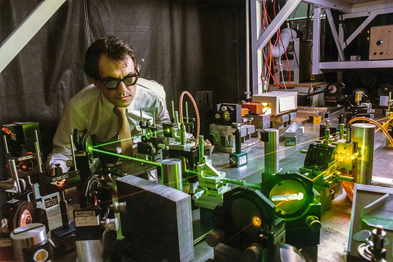 Gerard Mourou in the lab with laser beams
