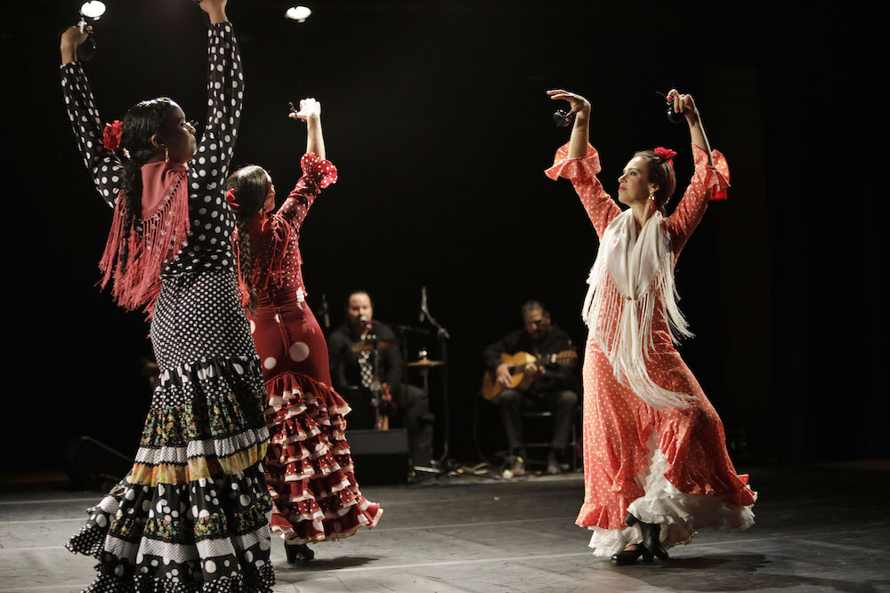 three women flamenco dancing