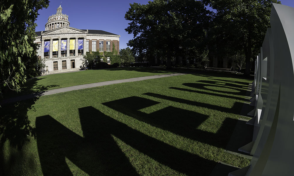shadow of meliora letters with rush rhees library tower in the background