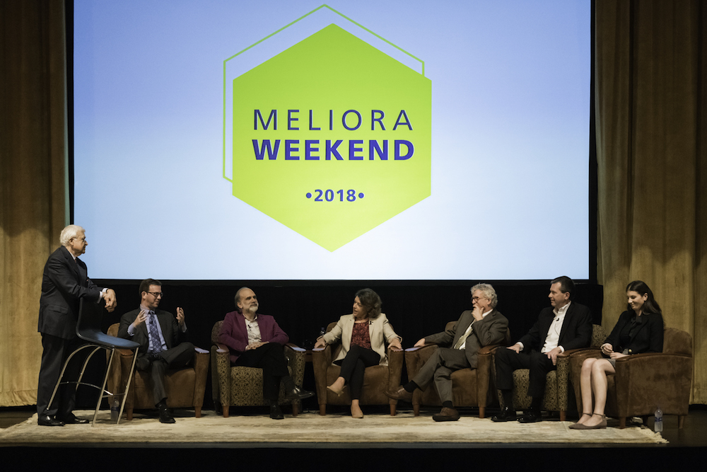 several panelists sitting on a stage