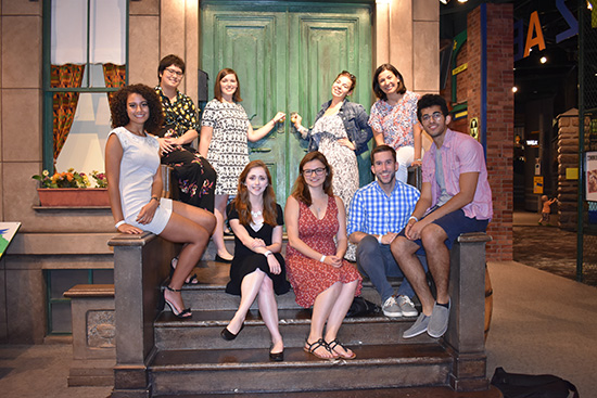 group photo of the Mellon Fellows in front of the Seseme Street set at the Strong Museum of Play