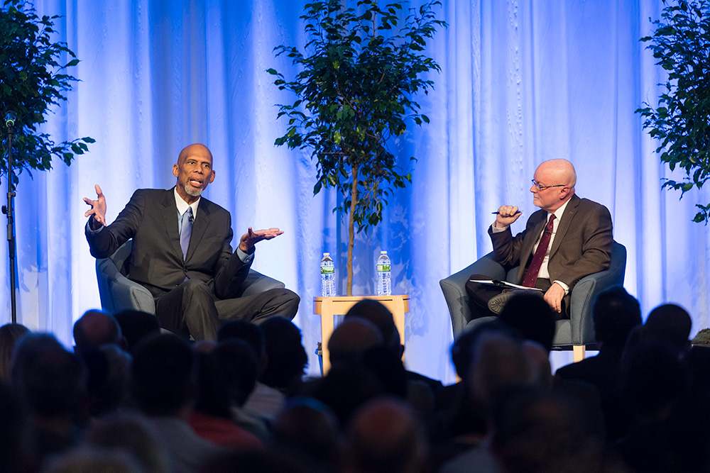 Kareem Abdul-Jabbar and Donald Hall sitting on stage having a conversation