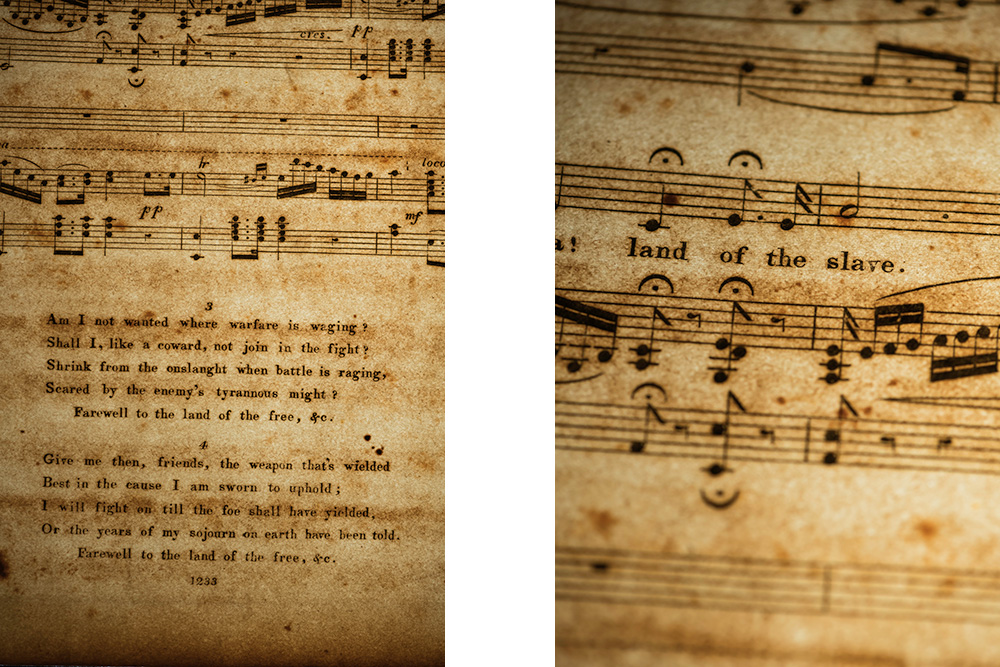 two close up details of sheet music, one containing the full lyrics listed below, and one a close-up detail showing the lyric LAND OF THE SLAVE