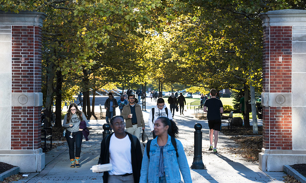 students walking around campus on a sunny fall day