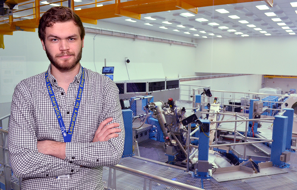 students stands in front of the OMEGA laser lab