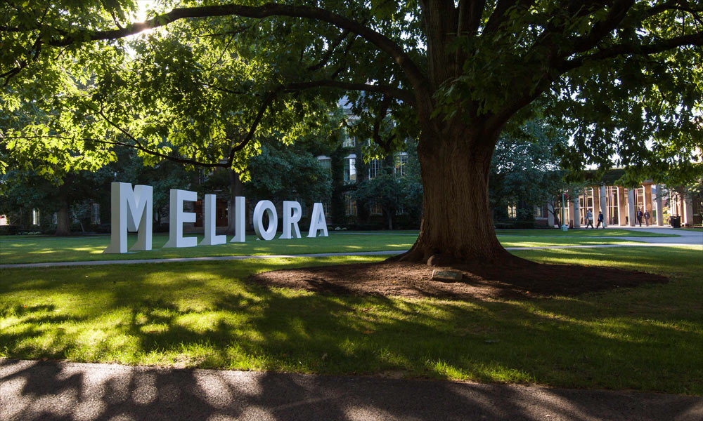 An image of the Eastman Quad with the letters Meliora spelled out.