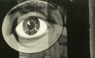 detail from a black and white photograph shows a close-up drawing of an eye