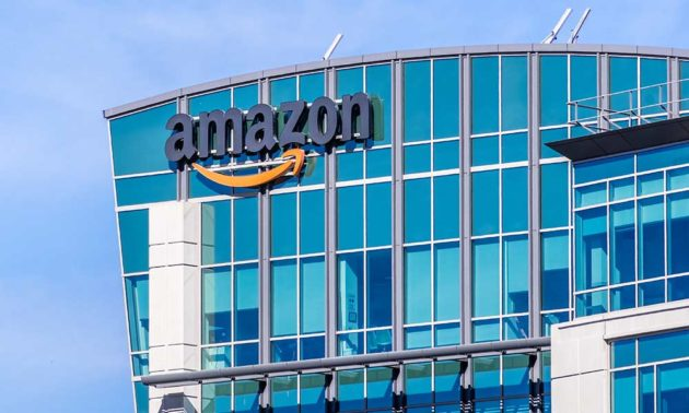 exterior of tall, glass building with the Amazon logo on the side