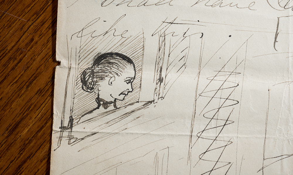 pen-and-ink illustration in the margin of a handwritten letter shows a woman looking sadly out a window