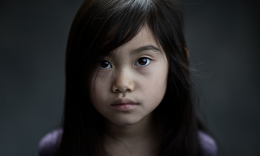 portrait of a child with a worried expression
