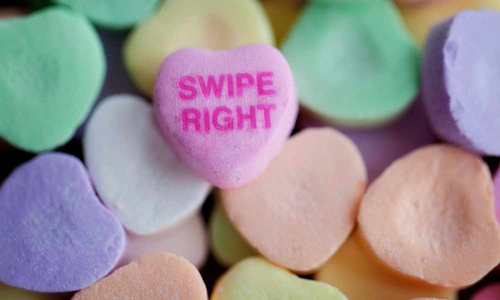 collage of candy conversation hearts, one of them says SWIPE RIGHT