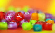 large pile of colorful beads, two of them with the letters X and Y