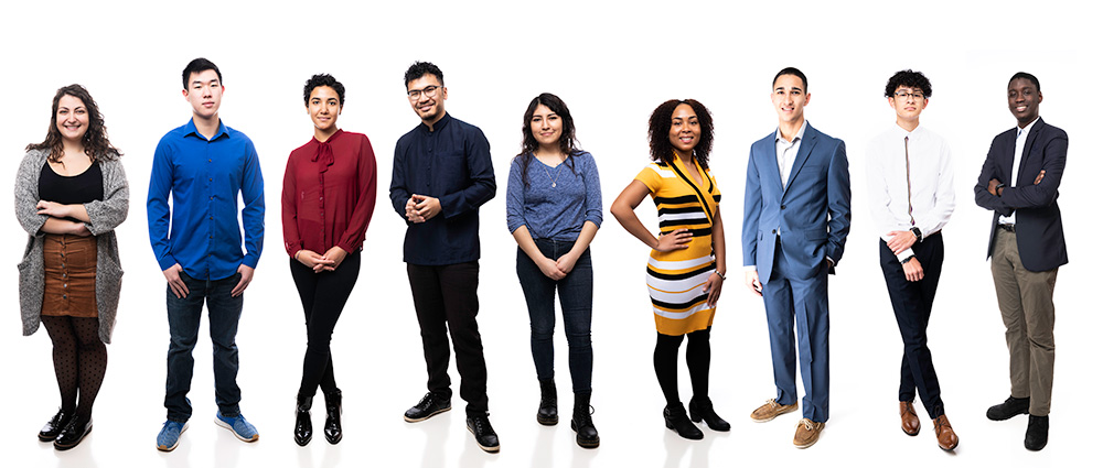 portraits of nine students all in a line