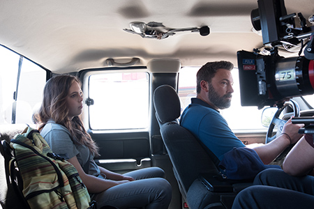 Two actors -- Maddy Wary and Ben Affleck -- filming a scene in a car.