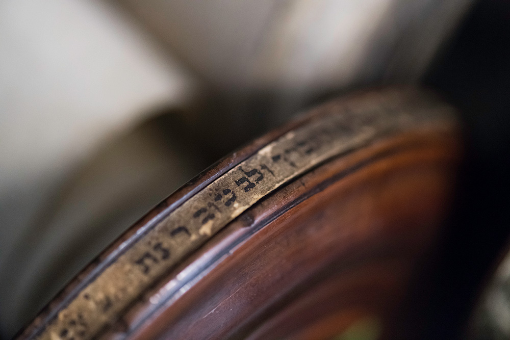 close-up of Hebrew text written on the side of a scroll