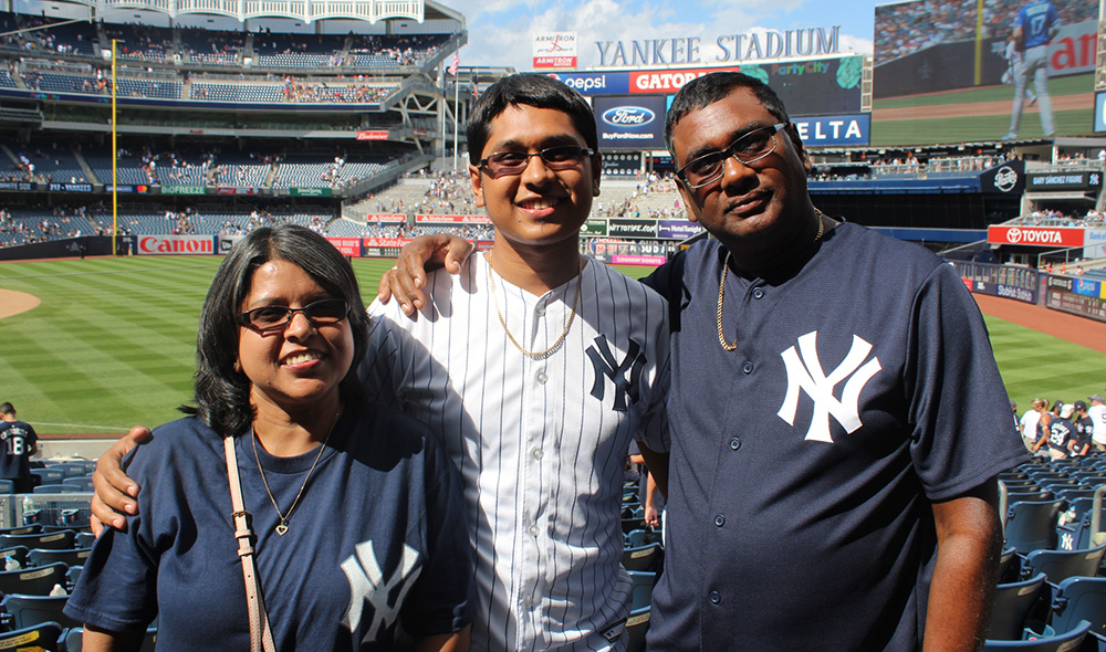 family posing at a baseball game