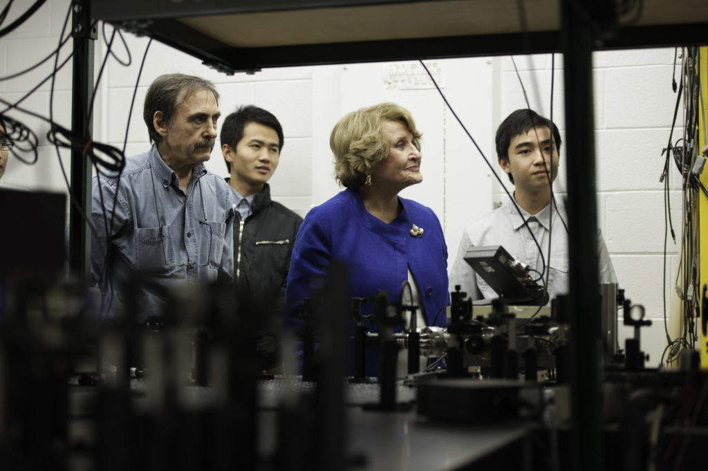 Louise Slaughter in a lab with three other scientists.