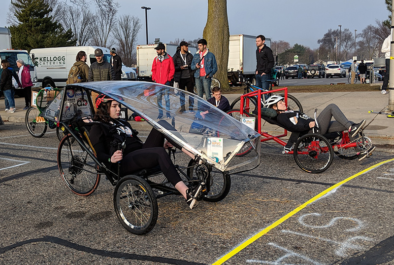 human-powered vehicles line up at the start of a race
