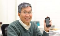 Ching Tang holds a smartphone that uses Organic Light Emitting Diodes (OLED) technology.