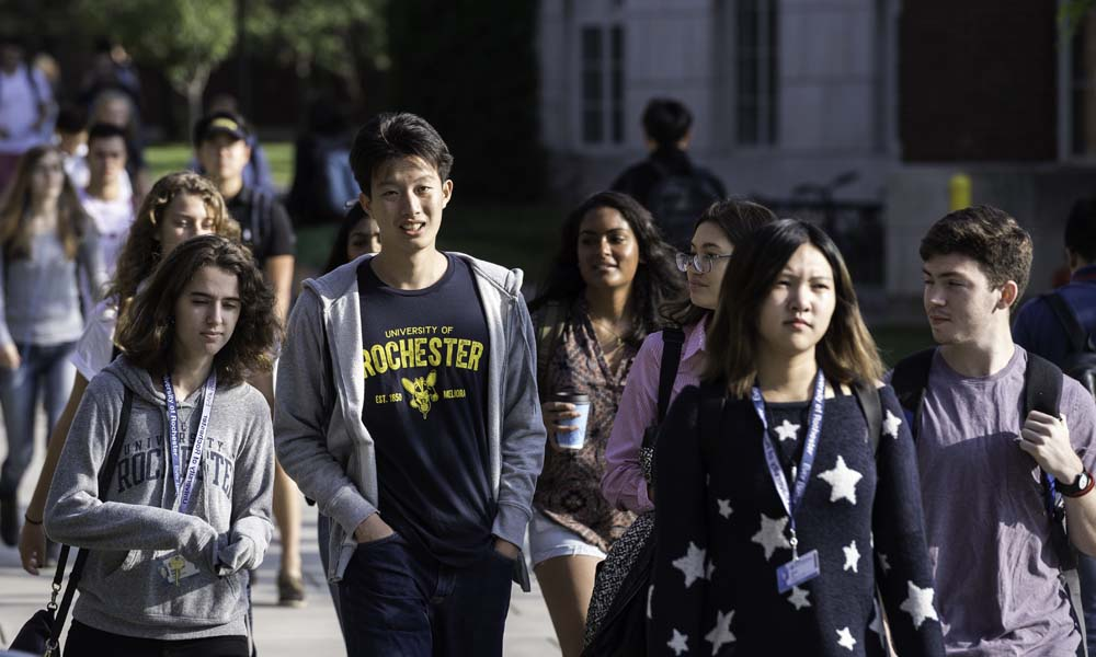 University of Rochester students walk on the River Campus during the first day of classes.