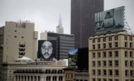 Billboard ad by Nike featuring Colin Kaepernick displayed prominently on the roof of the Nike Store in San Francisco.