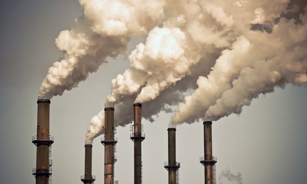 Six smokestacks release exhaust into the air, which contributes to rising ozone levels.