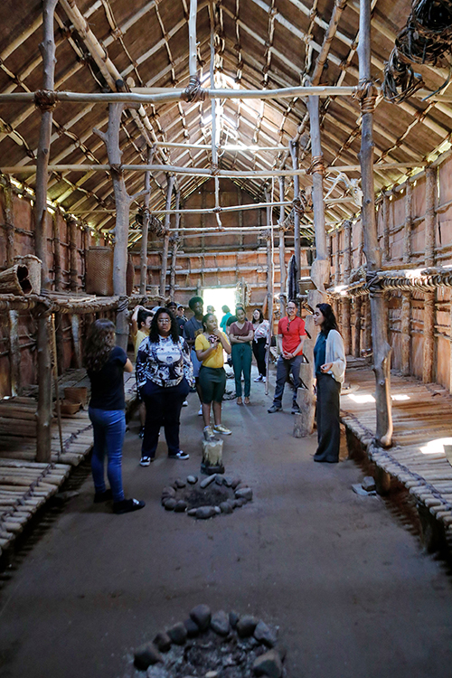 students looking up at the wooden roof of an