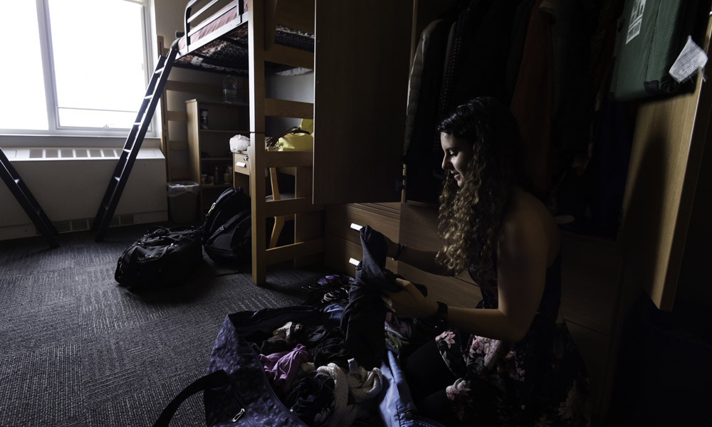 student sitting her her dorm room