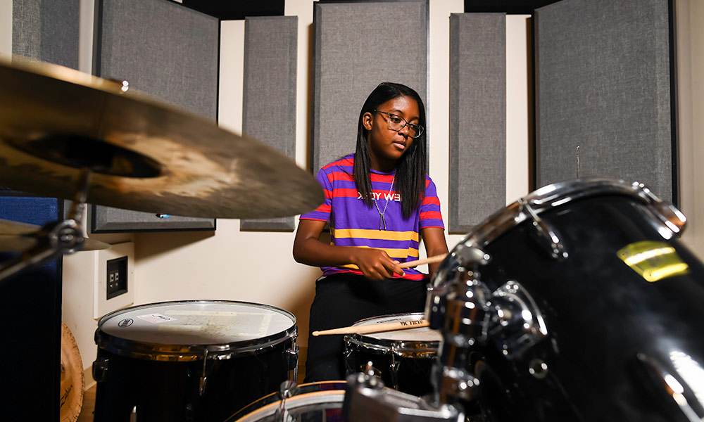 student playing the drums.