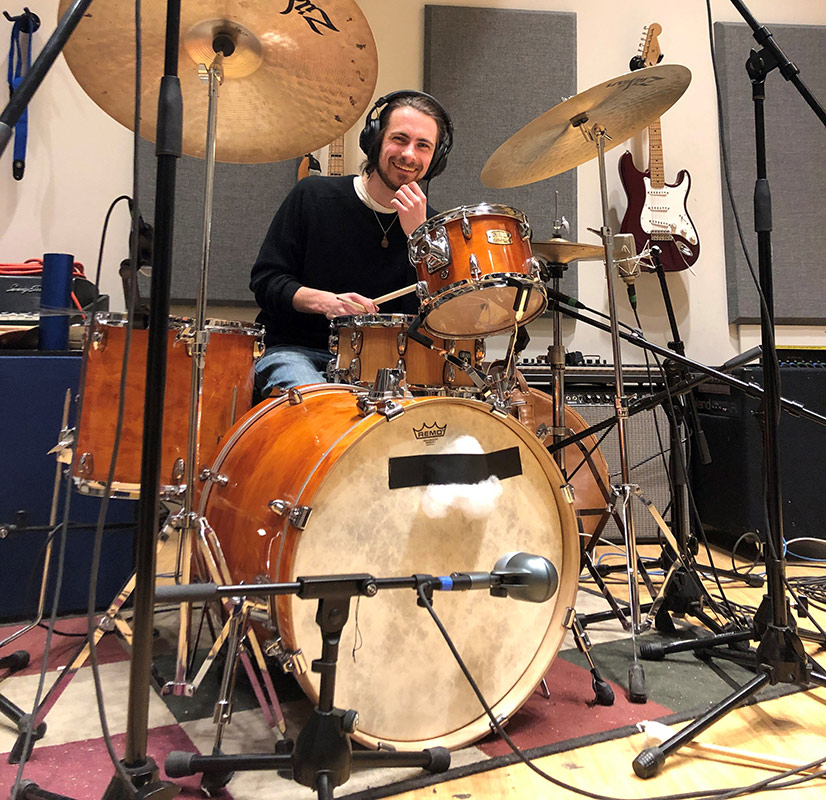 musician playing the drums in a recording studio.