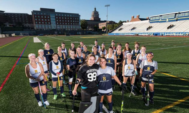 field hockey team pose for a photo
