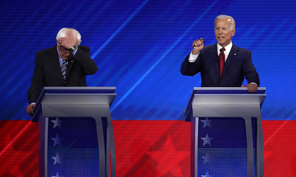 Joe Biden and Bernie Sanders on stage during the democratic debate.