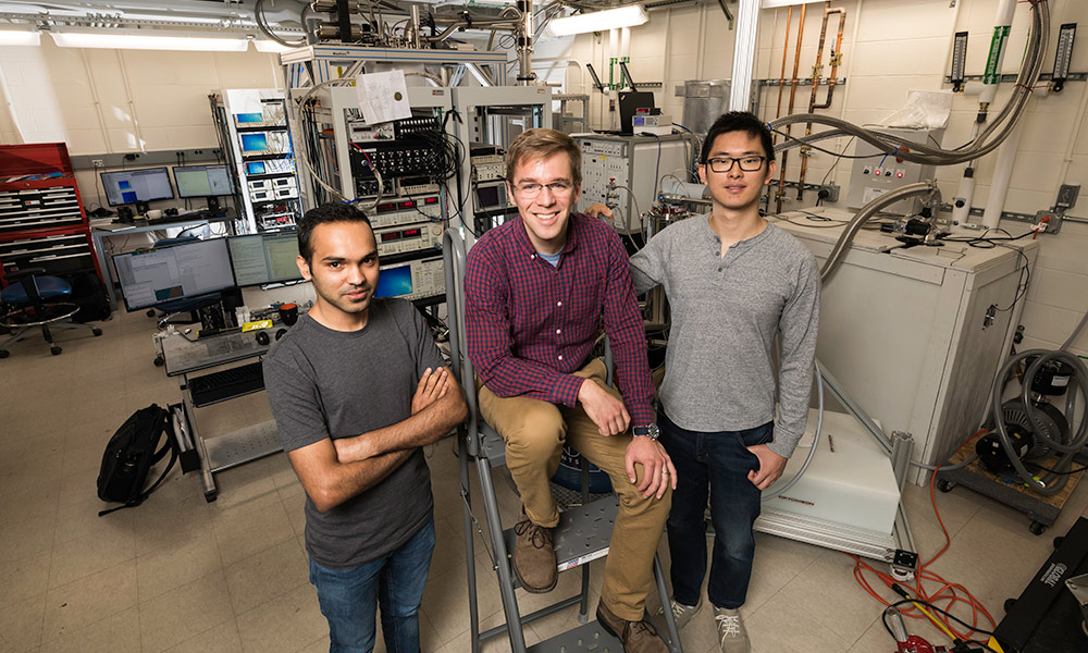 John Nichol and PhD students Yadav Kandel left, and Haifeng Qiao in Nichols's lab.