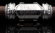 close-up on the engraved silver on the University mace shows the name of the new president, Sarah C. Mangelsdorf along with the date 2019-