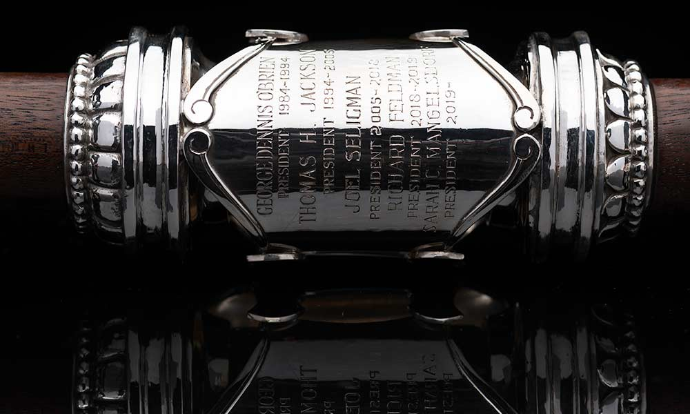 close-up of the mace engraved with the names of past presidents including new president Sarah C. Mangelsdorf