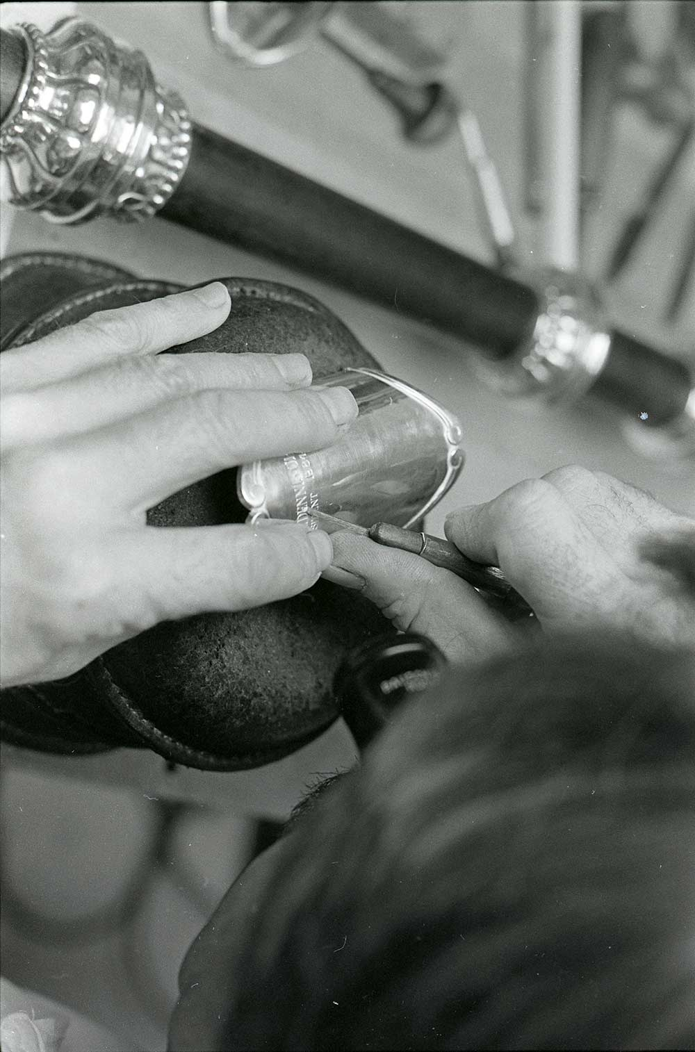 close-up photos of hands engraving a mace