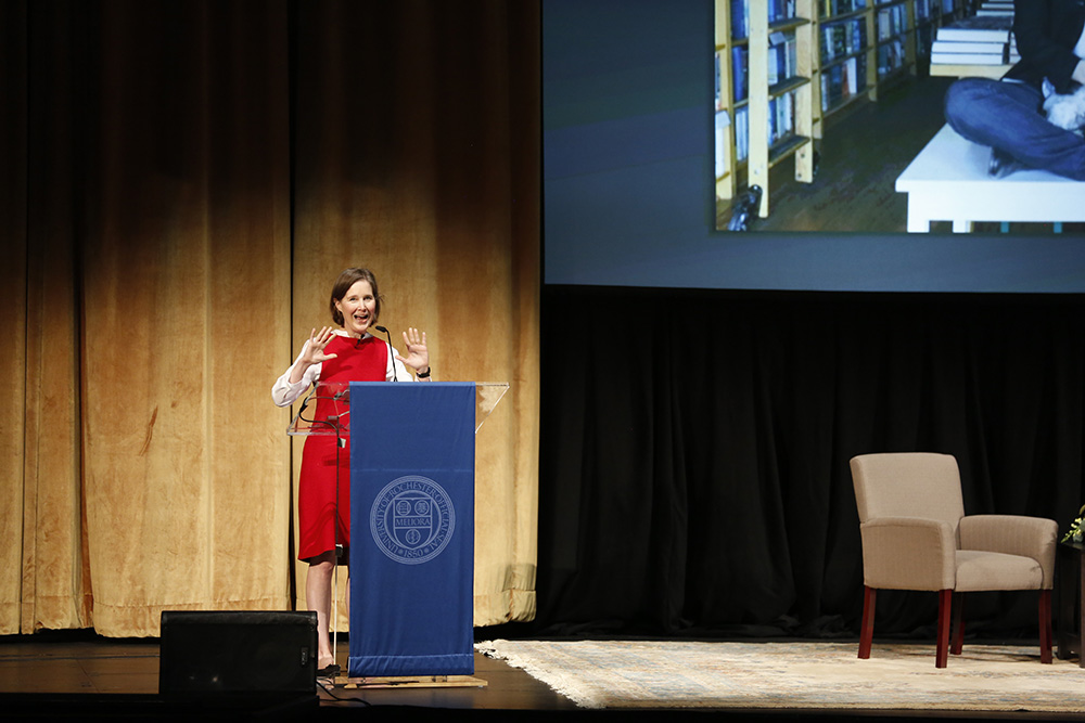 ann patchett stands at podium