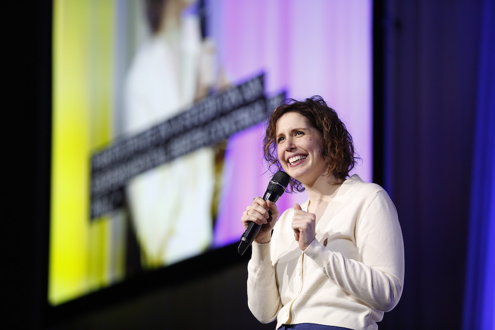 Vanessa Bayer holding microphone