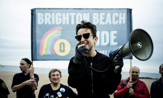 Masha Gessen speaks into a megaphone during the LGBT Pride March.