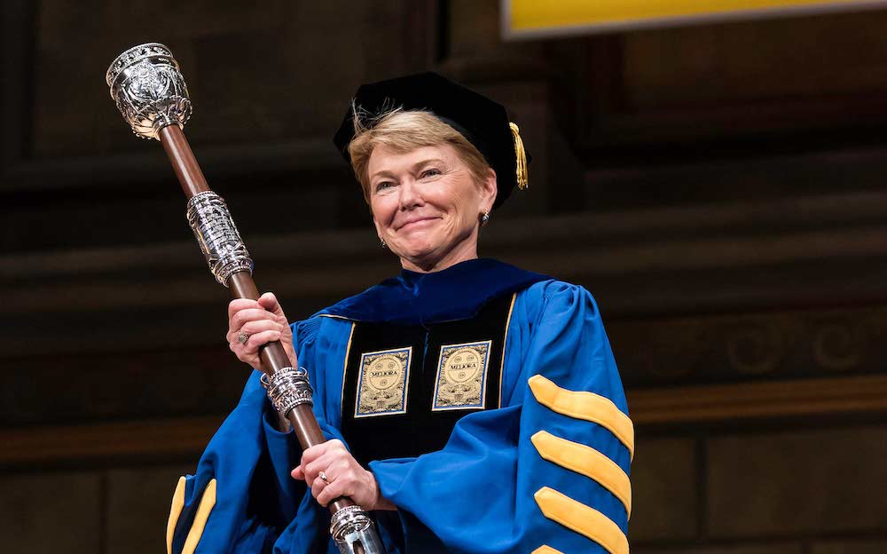 Sarah Mangelsdorf holding the university mace