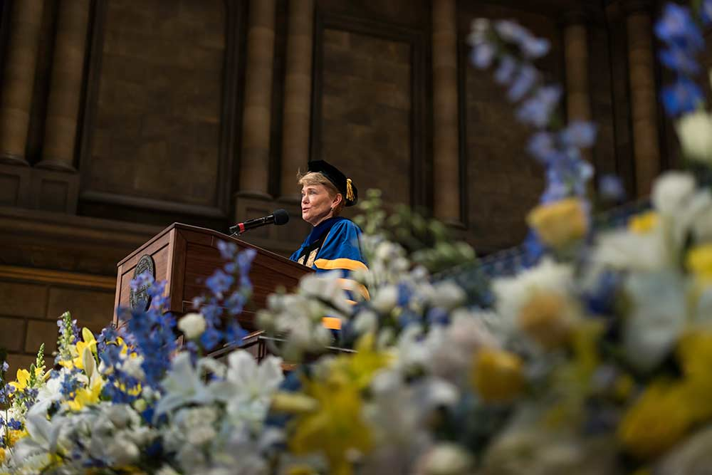 Sarah Mangelsdorf speaking at podium.