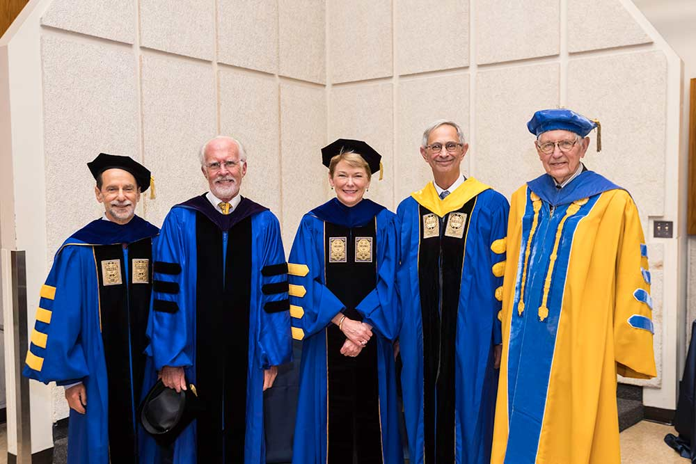 portrait of five presidents in academic robes