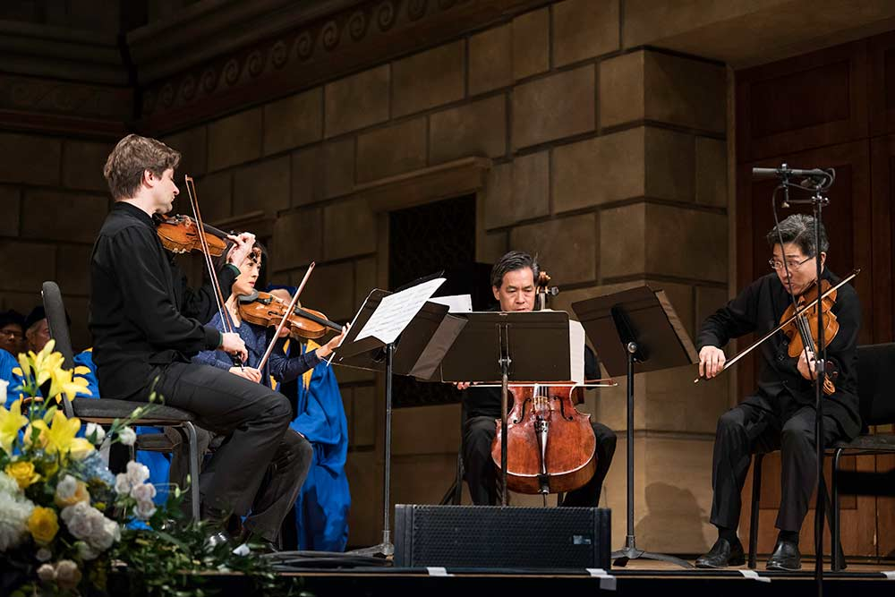 string quartet performs on stage