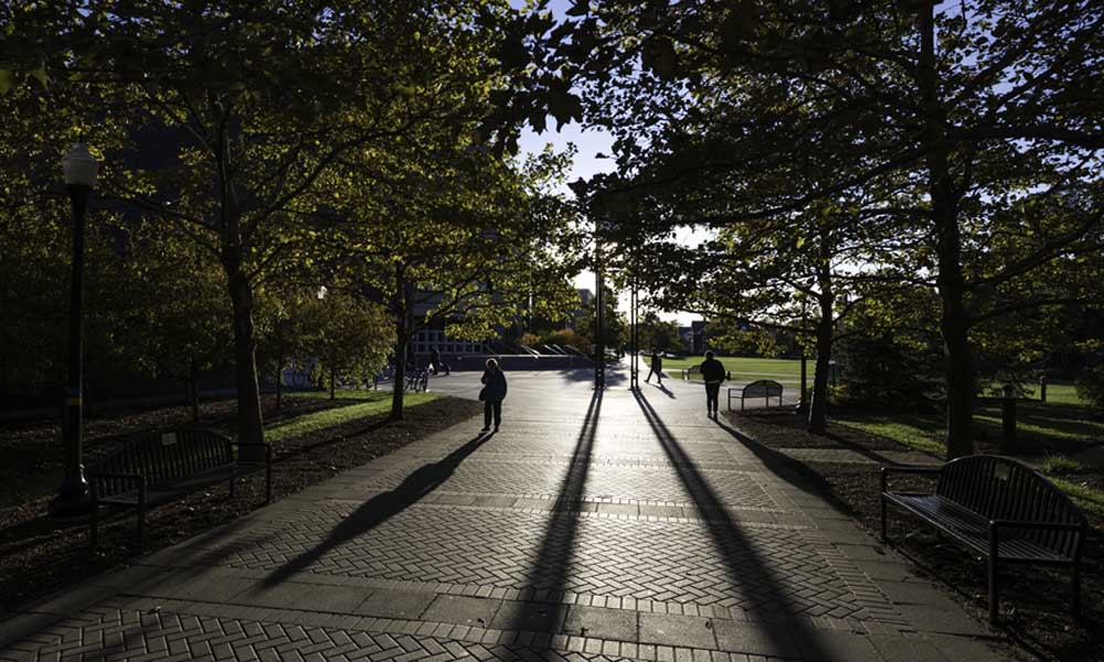 Students walk through Dandelion Square in the fall..