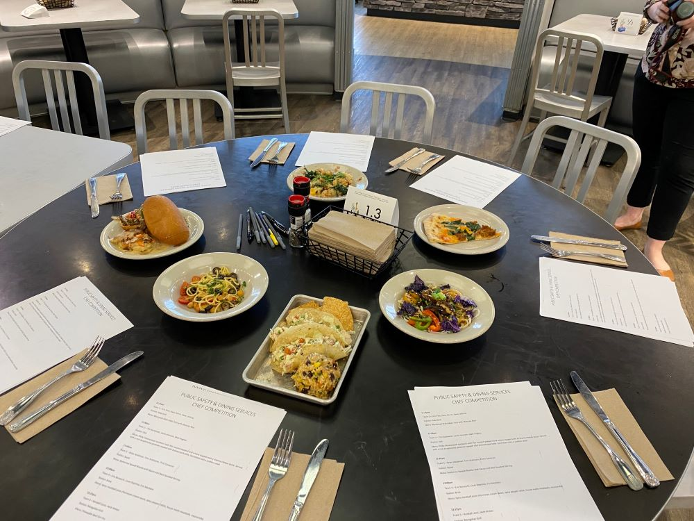 table filled with six dishes and voting ballots.