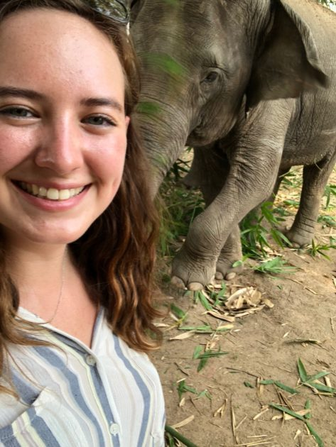 student selfie with elephant