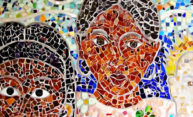 detail of a mosaic showing the faces of two people.