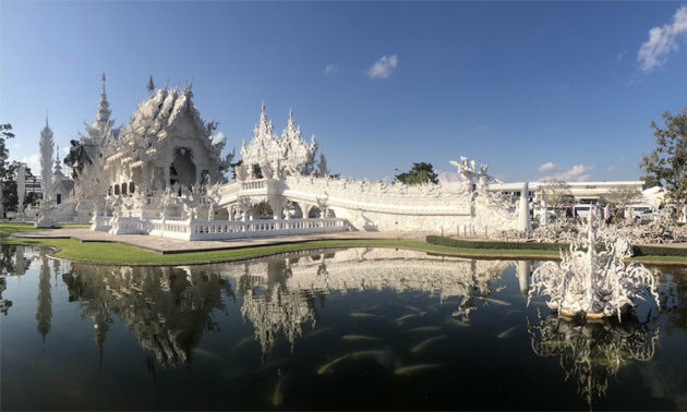 photo of white temple in Thailand